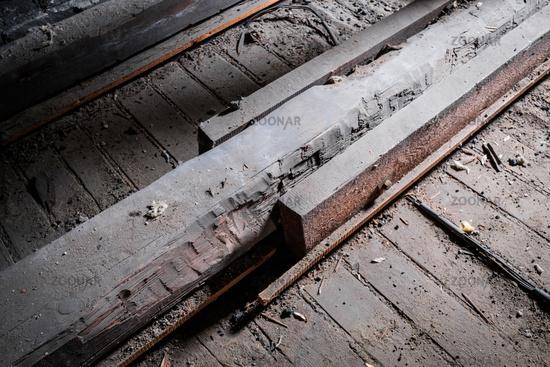 weak wooden floor beam in old attic / loft with support construction