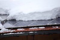 some snow on a photovoltaic cell