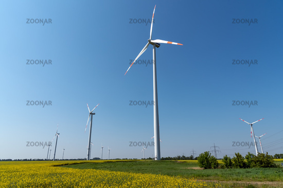 Wind energy plants in front of a clear blue sky seen in Germany