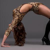 Dancer in leotard and high heels posing at studio