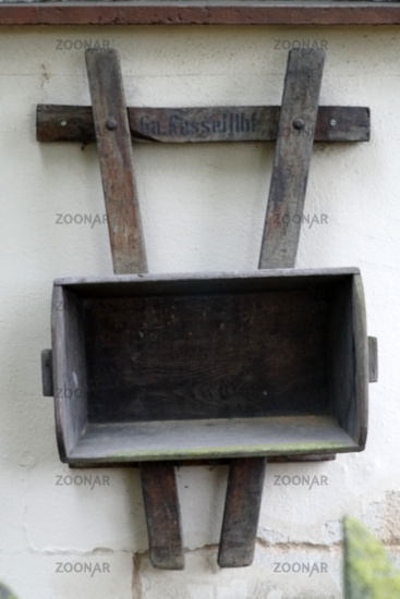 Wooden cart on the wall