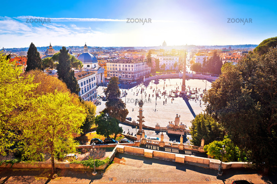 Piazza del Popolo or Peoples square in eternal city of Rome sun haze view