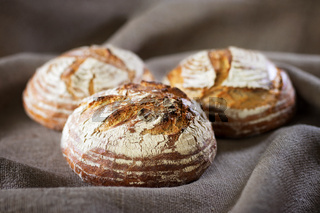 Three industrial round rye bread