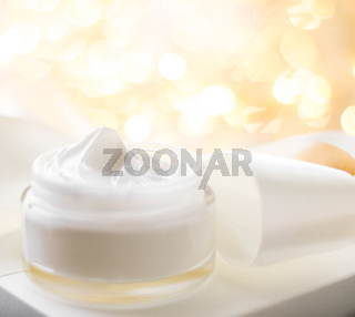 Facial cream moisturizer jar on holiday glitter background, moisturizing skin care as lifting emulsion, anti-age cosmetics for luxury beauty skincare brand