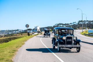 Participants of the winter parade of vintage cars entering the city of Punta del Este, Maldonado, Uruguay