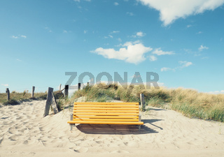 Empty yellow bench on a beach