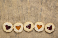 jam heart biscuits on textured paper