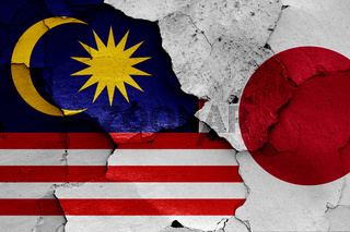 flags of Malaysia and Japan painted on cracked wall