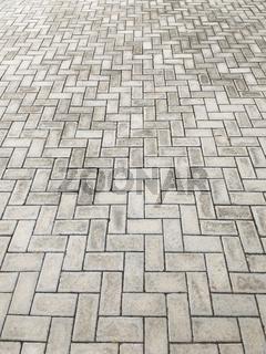 Perspective of rectangular blocks of embedded cement blocks.
