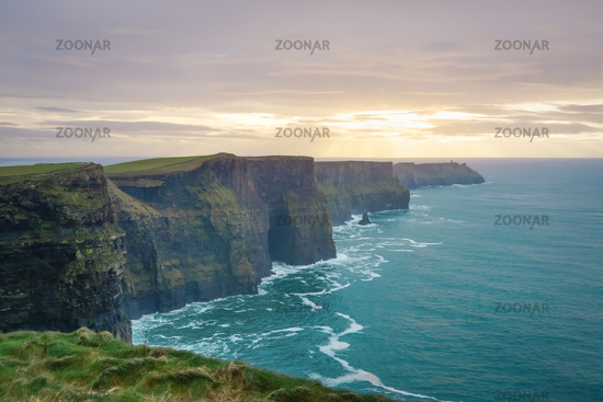 Cliffs of Moher in Wild Atlantic Way with beautiful sunset and turquoise water