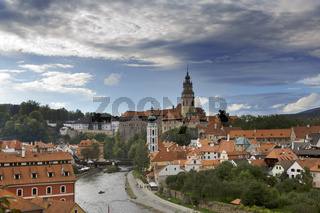 Cesky Krumlov castle and ancient historical houses and sky with stormy clouds