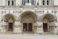 close up view of the three doors of the historic Saint Michel Church in the old city center of Dijon