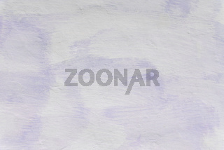 Adobe wall whitewashed by lime, white and violet color, textured background in retro style, closeup