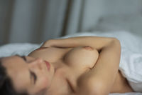attractive girl torso on bed