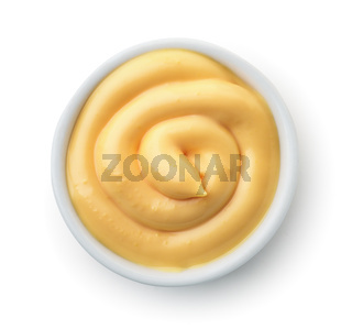 Top view of ramekin with cheese sauce