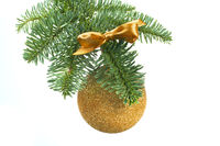 Christmas tree and golden ball on white