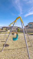 Vertical frame A-frame kids swings in an urban playground