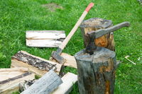 ax and cleaver on chopped firewood on a summer day