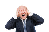 Loud shouting or screaming tired stressed businessman hands covering ears