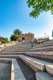 The Church of St John Aliturgetos and the Ancient Theatre in Nessebar ancient city on the Bulgarian Black Sea Coast. Nesebar or Nesebr is a UNESCO World Heritage Site. A church in Nessebar