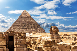 The Sphinx, the Temple and the Pyramid of Chephren under the clouds in Giza