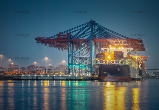 Container ship in the port of Hamburg at night