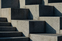 Abstract stairs, steps made of granite, often seen on monuments and landmarks,diagonal lit by bright sun light