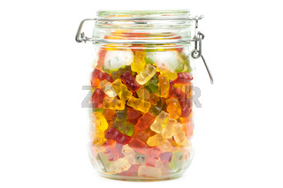 Colourful gummy bears / jelly baby candy sweets in a jar on a white background