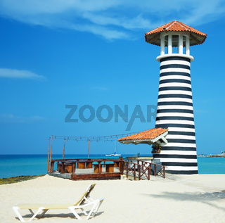 striped lighthouse on the caribbean