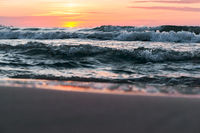 sea waves red from sunlight, sunset on the sea