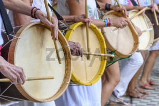 Some womans playing drums