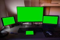 Four green screens on the desktop