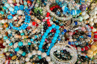 Colorful bracelets with stones and corals.