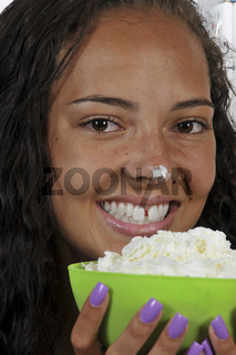 Woman holding whipped cream
