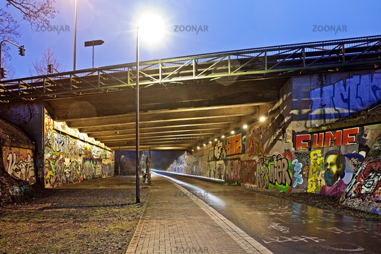 former railway line Nardbahntrasse, now pesestrian and cycle path in the evening, Wuppertal, Germany
