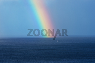 Beautiful rainbow on the ocean horizon