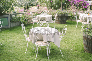 Romantic garden setting with vintage furniture