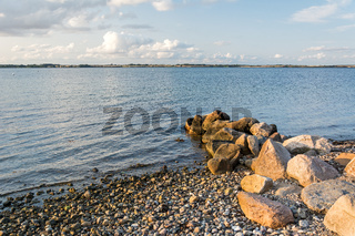 Scenic stony beach and rocks at the Baltic Sea at sunset