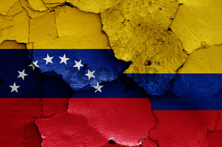 flags of Venezuela and Colombia painted on cracked wall