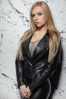 Cute blonde woman posing in studio