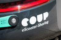 Coup eSooter sharing company logo on electric scooter closeup