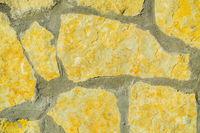 Stone wall pattern. Big concrete bricks outside.