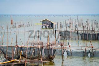 Fishermen hut and nets at Songkhla lake