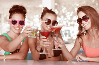 Three friends with cocktails