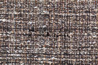 motley woven yarns of boucle fabric close up