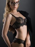 Slim blonde in lace underwear studio shot