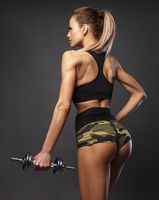 Beautiful sports fitness woman with dumbbells, beautiful buttocks