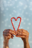 Love sweet blessings at Christmas. Candy cane heart