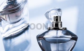 Blue perfume bottle on glossy background, sweet floral scent, glamour fragrance and eau de parfum as holiday gift and luxury beauty cosmetics brand design