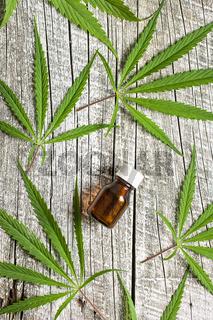 Marijuana cannabis leaves and cannabis oil extract in jar.